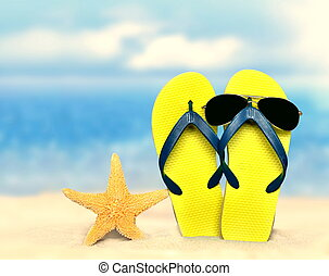 Flip-flops and sunglasses with starfish on beach