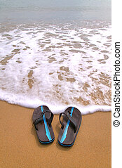 Flip flops at the beach vertical.
