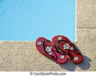 Flip-flops by the pool