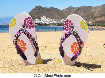 Flip-flops in the sand of Teresitas beach. Tenerife island, ...