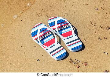 Flip flops near sea