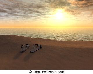 Flip flops on a beach at sunset.