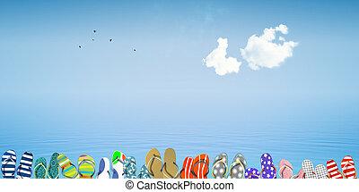 Flip flops on beach against the sea