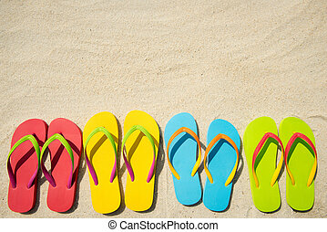 Flip flops on beach - Four pairs of beach sandals on white ...