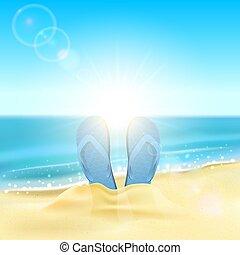 Flip flops on the sandy beach