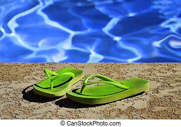 Flip Flops Sandals by Swimming Pool - Detail of flip flops...