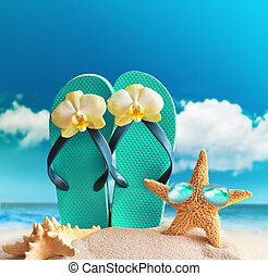 Flip-flops, sunglasses with starfish on summer beach