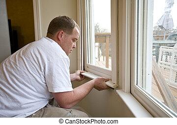 Flip houses - Carpenter repairing window frames, home is ...