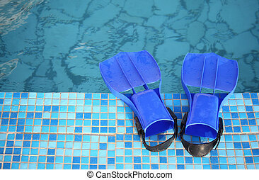 flippers on the brink of pool
