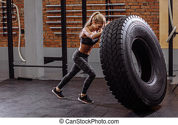 flipping a huge tire at gym.