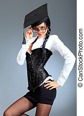 flirt - An attractive young woman in spectacles posing over...