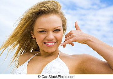 Flirt - Portrait of beautiful blonde on background of cloudy...