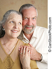 Flirtation - A good looking mature couple flirting with each...