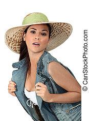 Flirtatious brunette wearing hat