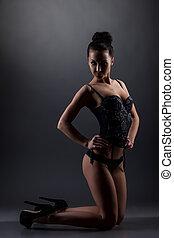 Flirtatious girl in underwear, on gray background