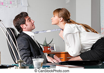 flirting at work - businesswoman is seducing her boss at...