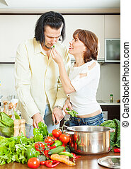 Flirting couple in home kitchen