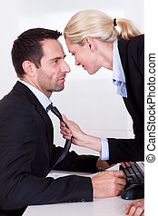 Flirting in the office as a beautiful blonde businesswoman...
