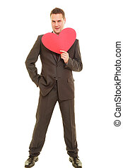 Flirting man in suit holding heart love symbol