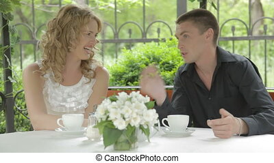 Flirting young couple sweetly talki