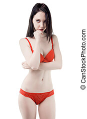 Flirting young woman in red lingerie