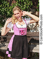 Flirty blond bavarian girl in dirnd