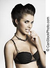 flirty brunette in black lingerie - very elegant and sensual...