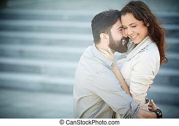 Flirty couple - Image of joyful dates embracing outside