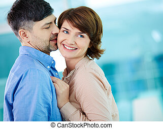 Flirty kiss - Portrait of happy middle aged woman enjoying ...