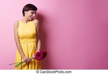 Flirty woman photographing in studio