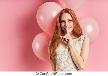 flirty woman with red hair isolated