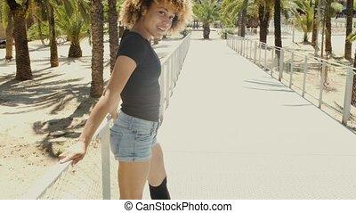 Flirty young black woman on street