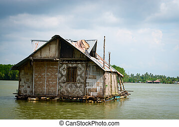 Float bamboo house on tropical river