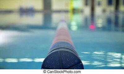 Float lane of empty swimming pool
