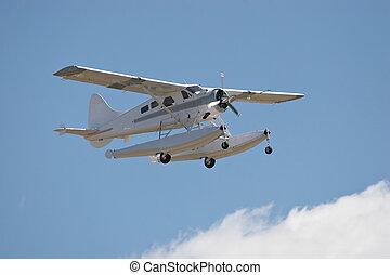 Float Plane - Amphibious landing aircraft in flight