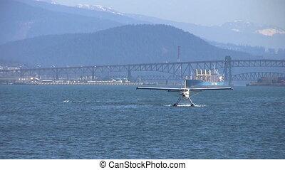 Float Plane Approaching Pier - A float plane approaches a...