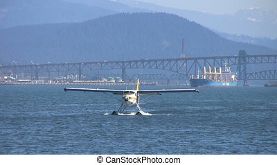 Float Plane Approachs Pier Close Up - A close up shot of a...