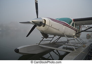 Float plane in the fog - float plane in the fog.