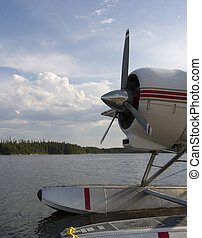 a float plane tied up on a dock in Quebec