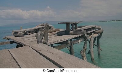 Treasure Beach, Negril, Jamaica - August 8, 2018: Selective focus of floating bar on ocean for people to sit and enjoy water life and relax