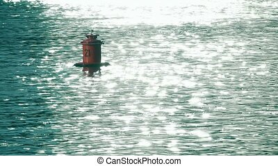 Floating buoy with number 21 on it. Slow motion shot -...