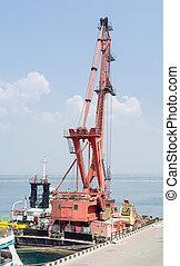 Floating crane at the seaport berth