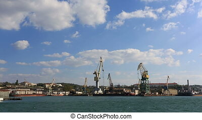 Floating cranes parked in Sevastopol bay, Crimea - Water...
