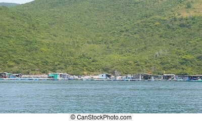 Floating fishing village, Vietnam. View from moving boat