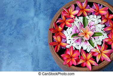 Floating flowers - Tropical flowers floating in water. Taken...
