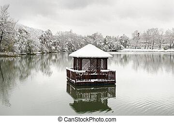 floating gazebo in the lake in the winter