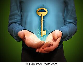 Floating golden key - Large golden key floating over a man's...