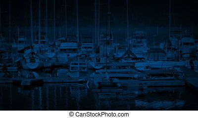 Floating Harbor With Many Boats At Night - Boats moored in...