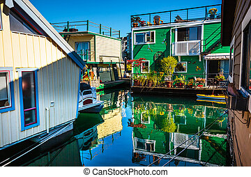 Floating Home Village Green Brown Houseboats Fisherman's Wharf Reflection Inner Harbor, Victoria Vancouver British Columbia Canada Pacific Northwest. Close to the center of Victoria, this area has floating homes, boats, piers, and restuarants.