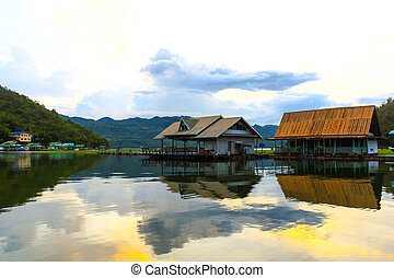 Floating House and Houseboat on the lake